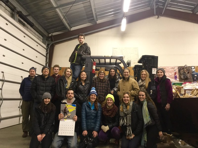 Group photo inside the building next to a forklift.