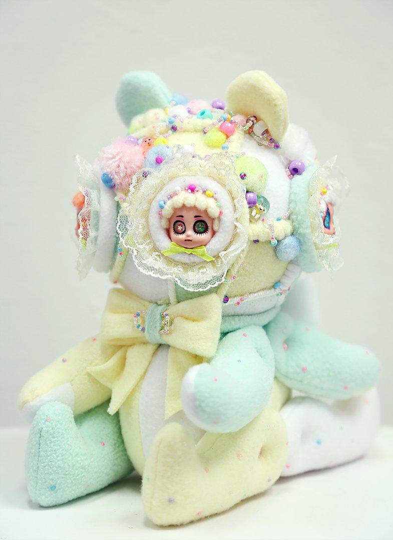 Multimedia soft sculpture in pastel tones resembling a stuffed animal 3/4 view.jpg
