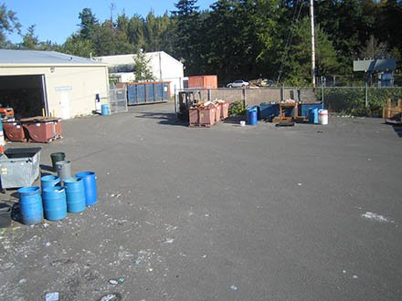 Recycle Center compound, with dumpsters and blue bins